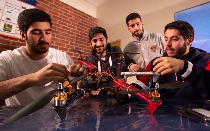 CSUF mechanical engineering students work on wildfire combating drone.