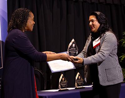 Zoila Gallegos receives Honor an Educator Award from Lisa Kirtman.