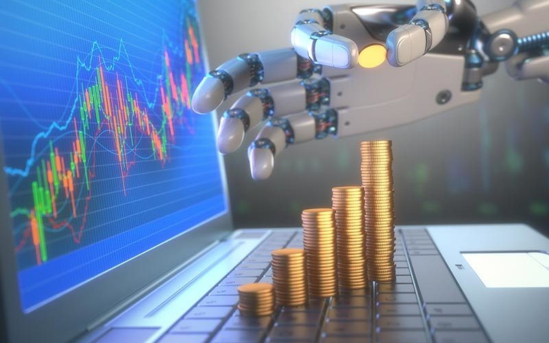 A robot hand counting money on laptop with graph on the rise