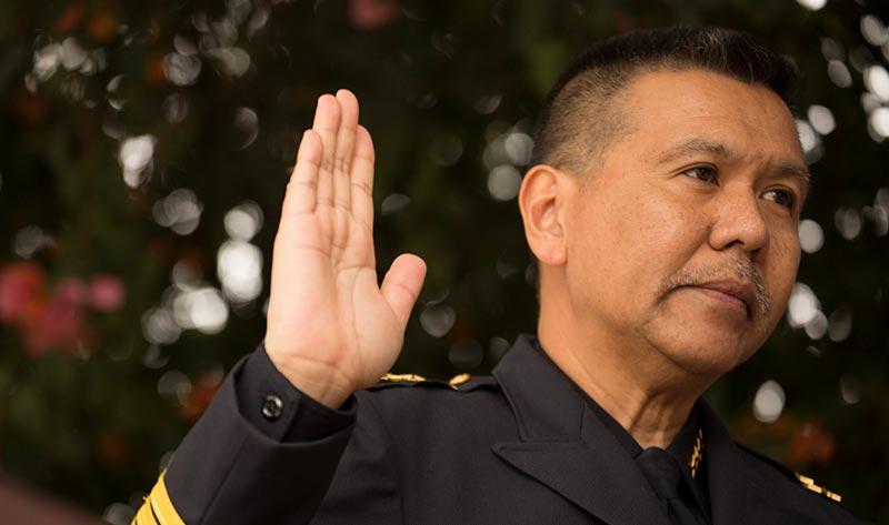 Police Chief Raymund Aguirre being sworn in.