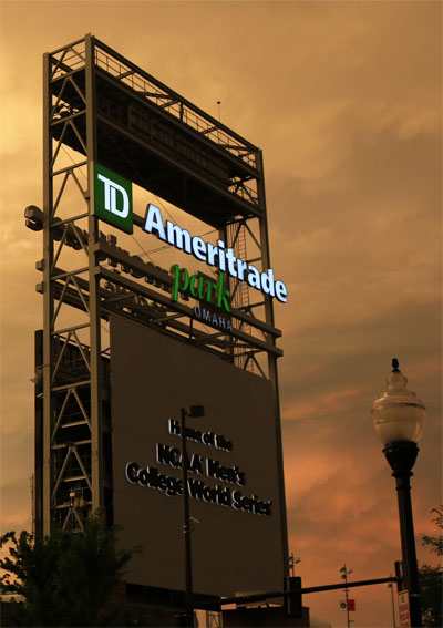 TD Ameritrade sign against dark clouds.