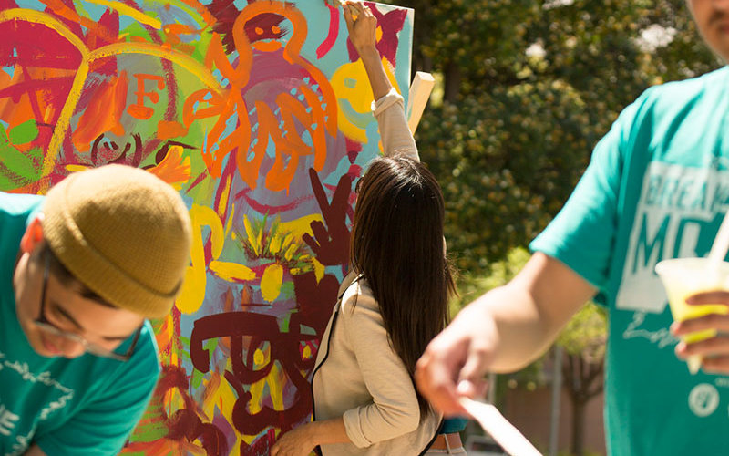Student painting during Arts Week