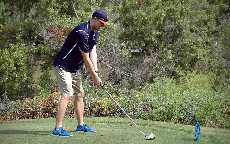 participant teeing up