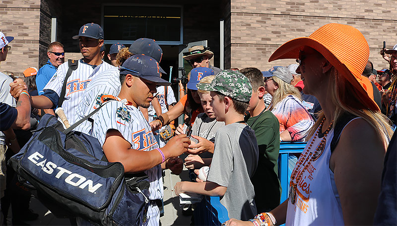 Hank LoForte signs autographs for young fans.