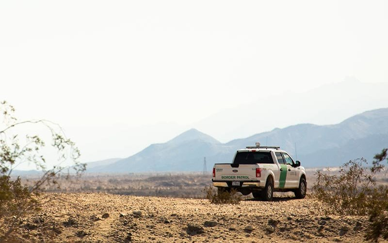 Border patrol vehicle with desert in background