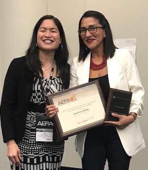 Carolina Valdez receiving award