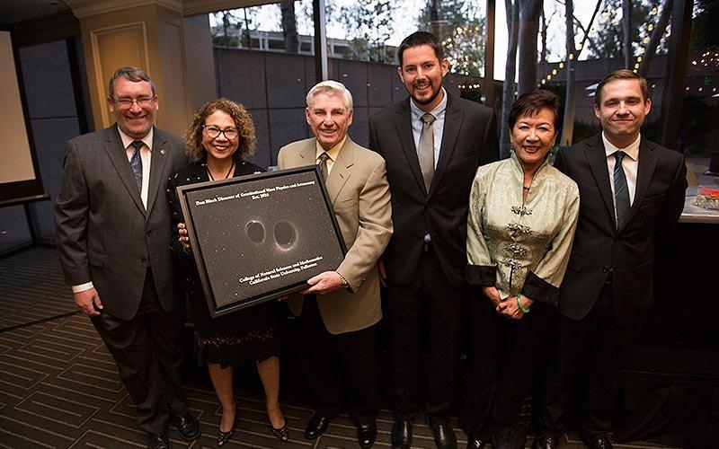 Dan Black presents gift to CSUF dignitaries