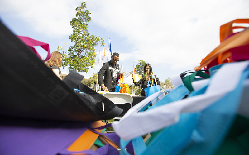 Vincent T. Harris and student Elizabeth Vergara fill bags for those in need during the Martin Luther King Jr. Day of Service event on campus.
