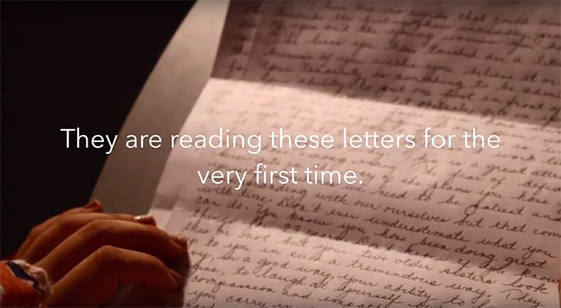 Students read their parents' letters for the first time.