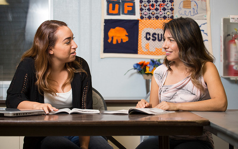 Two students conversing.