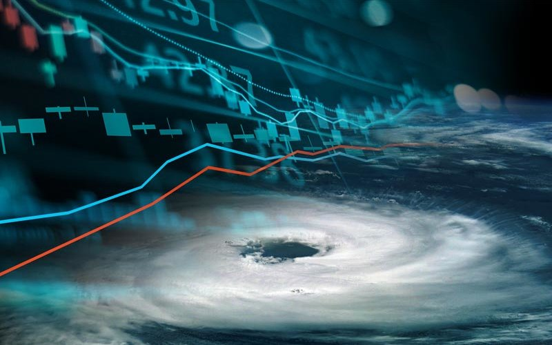 Eye of hurricane from space with financial graphics composite