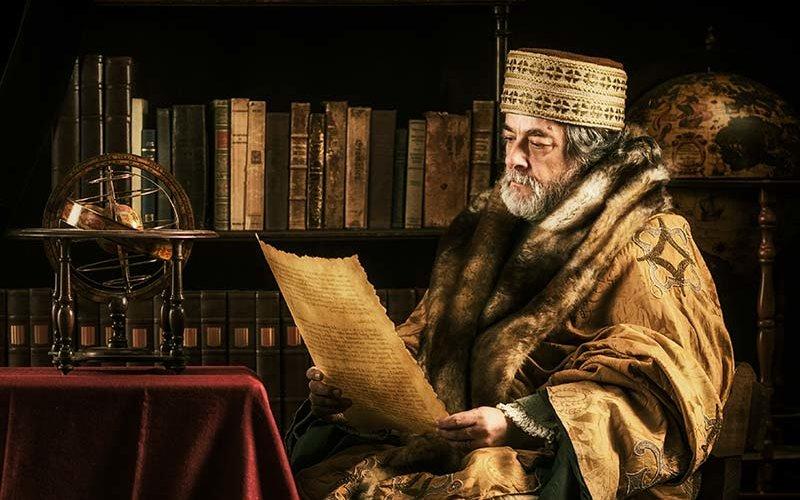 Scholar reading old parchment document