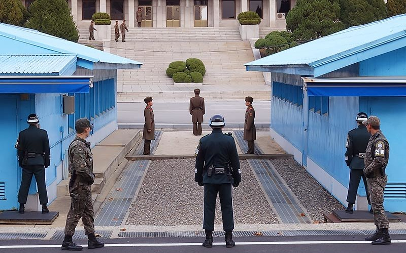 DMZ with South and North Korean soldiers facing each other.