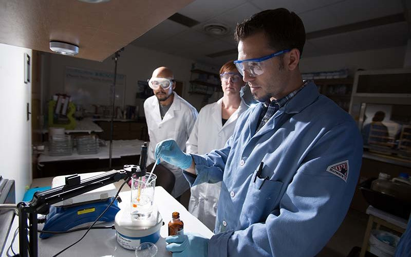 CSUF Staff & Faculty in lab