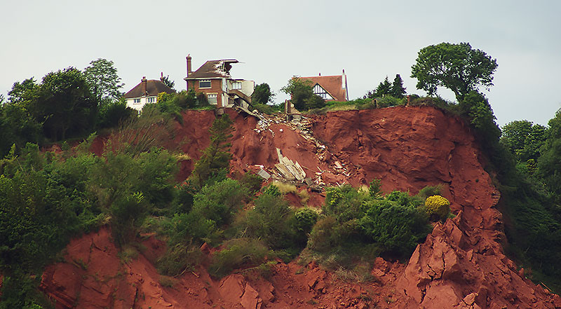 House collapsing off a landslide.