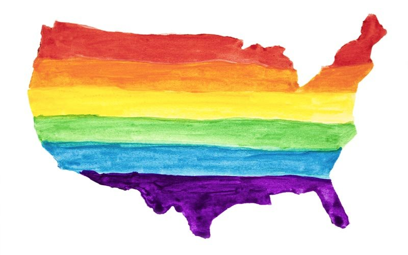 Watercolor painted rainbow United States of America map outline.