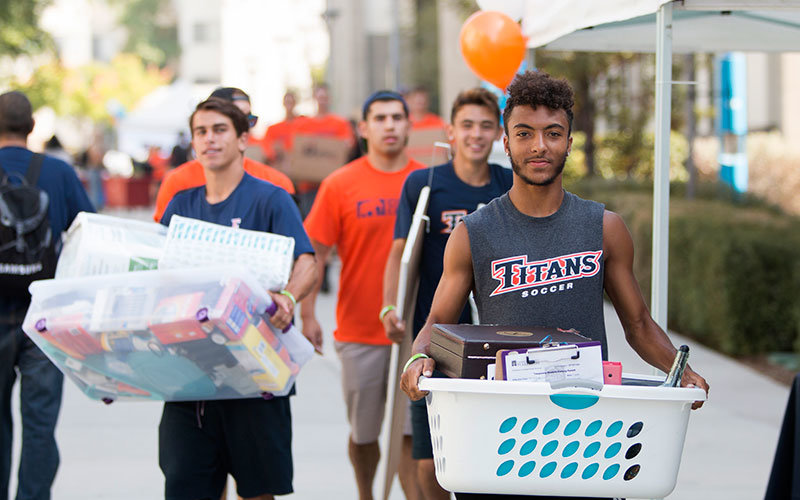 Students moving into on-campus housing.
