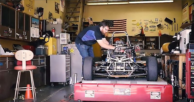 CSUF engineering student working on Formula race car.