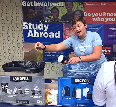 Maelynn Dickson speaking about recycling to fellow students.