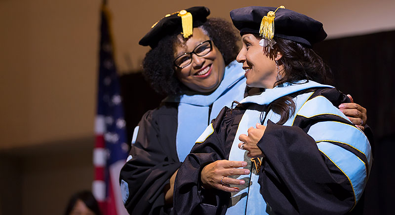 Andi Sims is congratulated by her faculty adviser Dawn Person