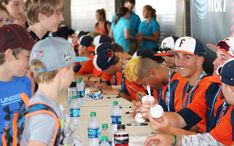Titan players signing autographs for young fans.