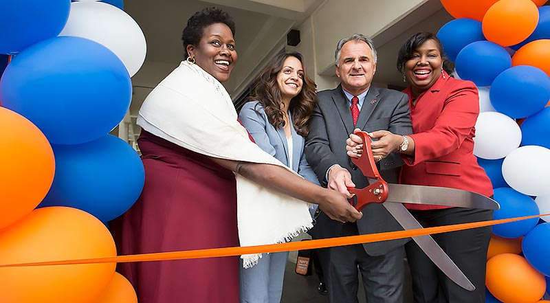Berenecea Eanes, Lalia Dadabhoy, President Fram Virjee, and Keya Allen at ribbon cutting ceremony..