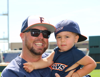 Cory Vanderhook holds his young son, Cayson.