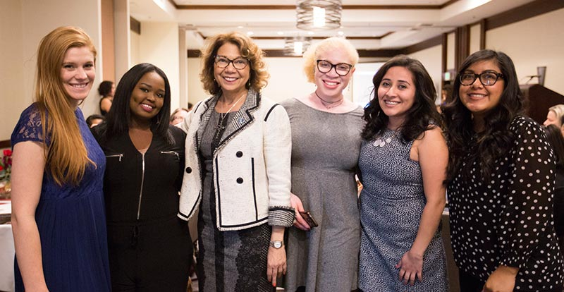 President Mildred García joins with students from the Women's Center.