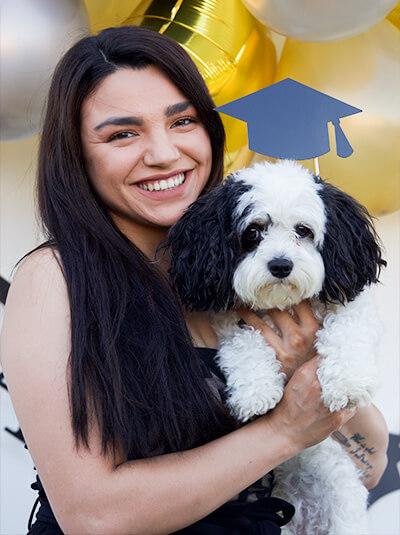 Genesis Osuna with dog graduating