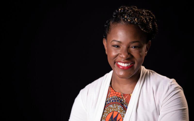 a Black woman smiling