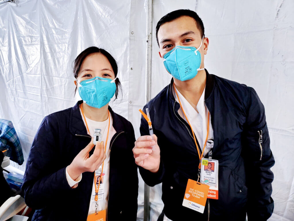 Kylee Meng and William Nubla, CSUF nursing students with vaccines