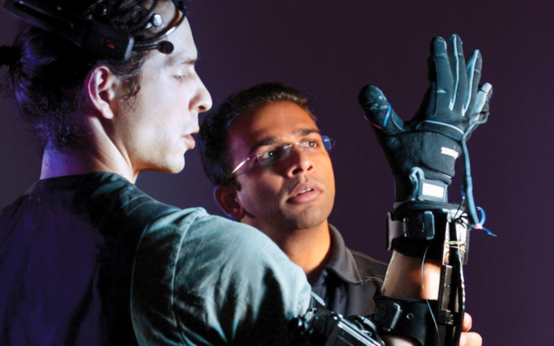 Kiran George with Robotic Arm and Student