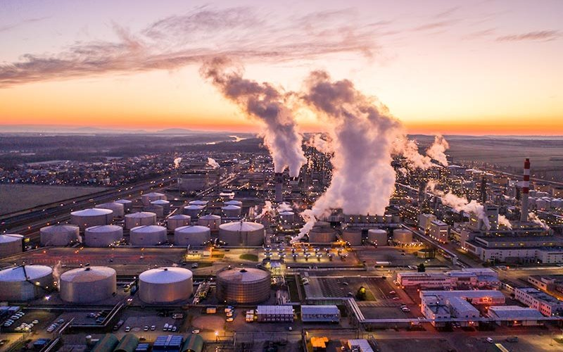 Aerial view of refinery at sunset