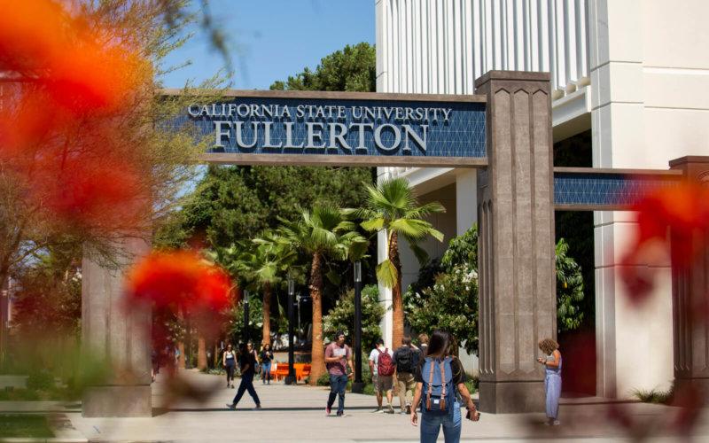 Students walk through campus gateway