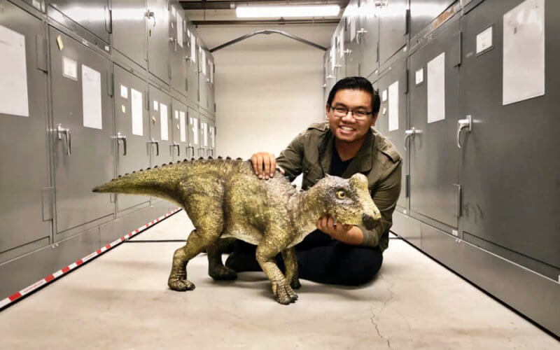 Gabe Santos with juvenile Parasaurolophus dinosaur