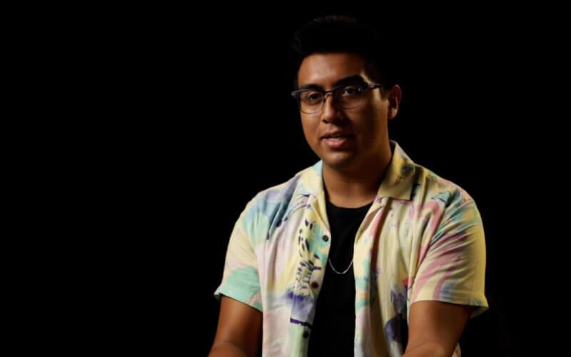 a man wearing eyeglasses sitting