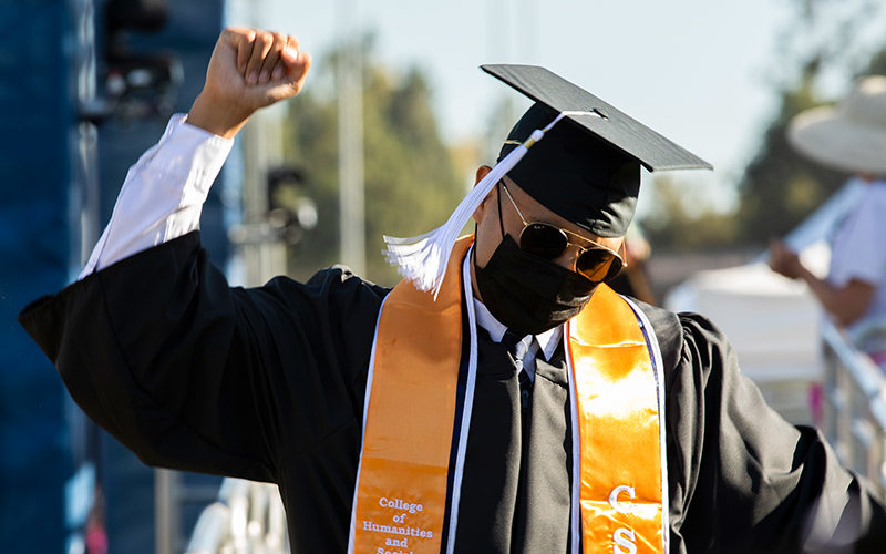 2020 Graduate celebrating on Commencement Stage