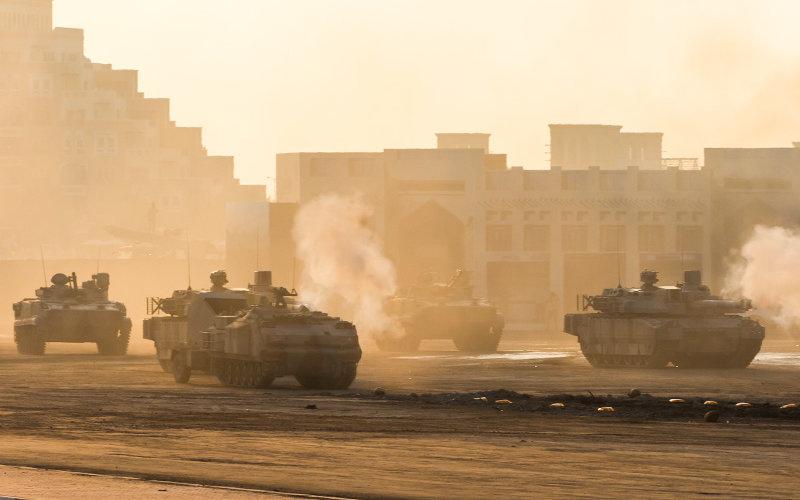 Tanks firing at sunset