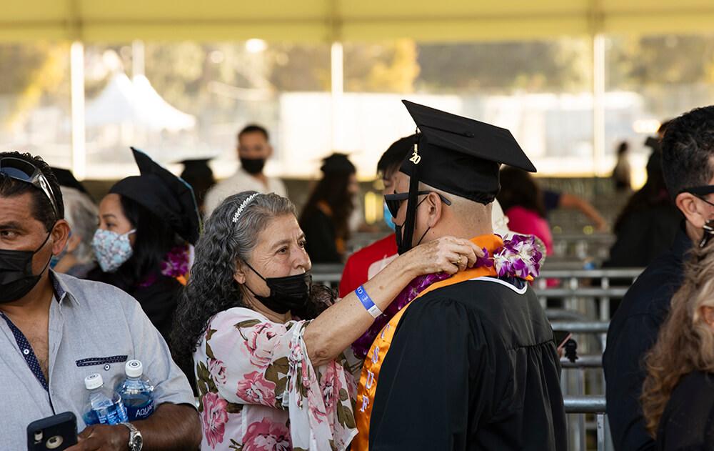 mother fixes graduates regalia