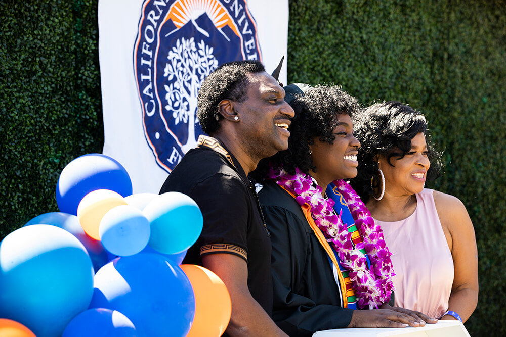 Family poses for photo with grad