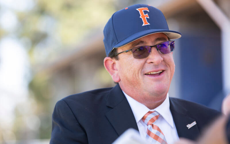 man wearing sunglasses and a baseball cap