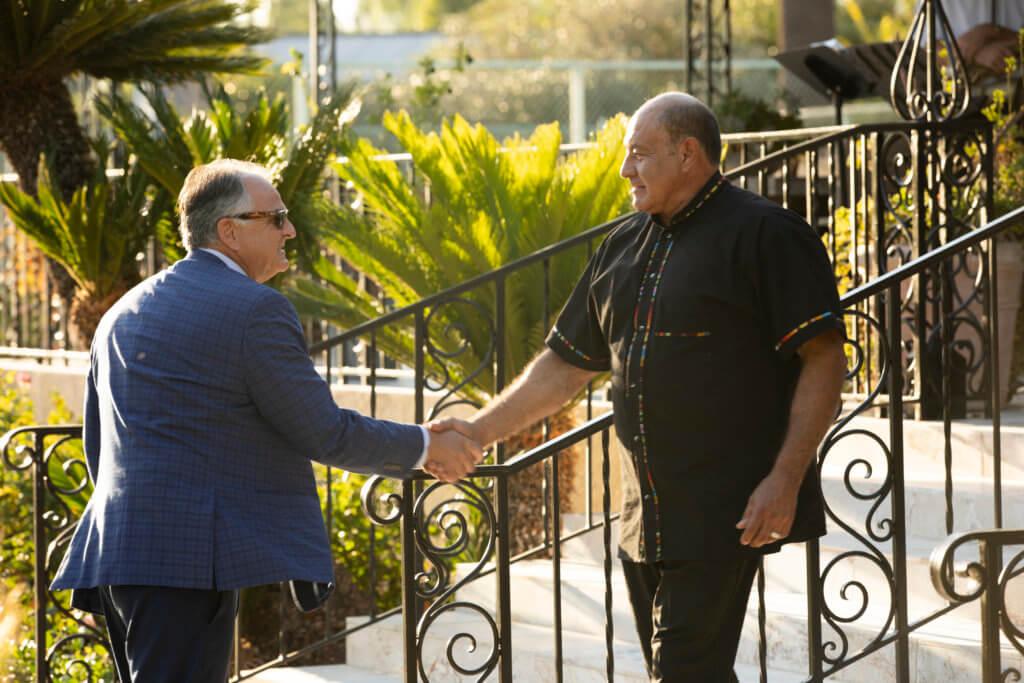 Fram Virjee greets Congressman Lou Correa