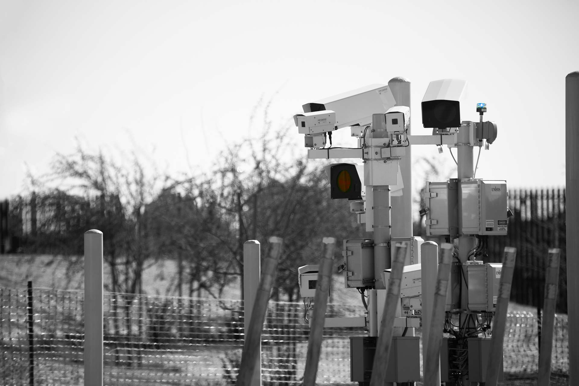 Security cameras and sensors at border fence